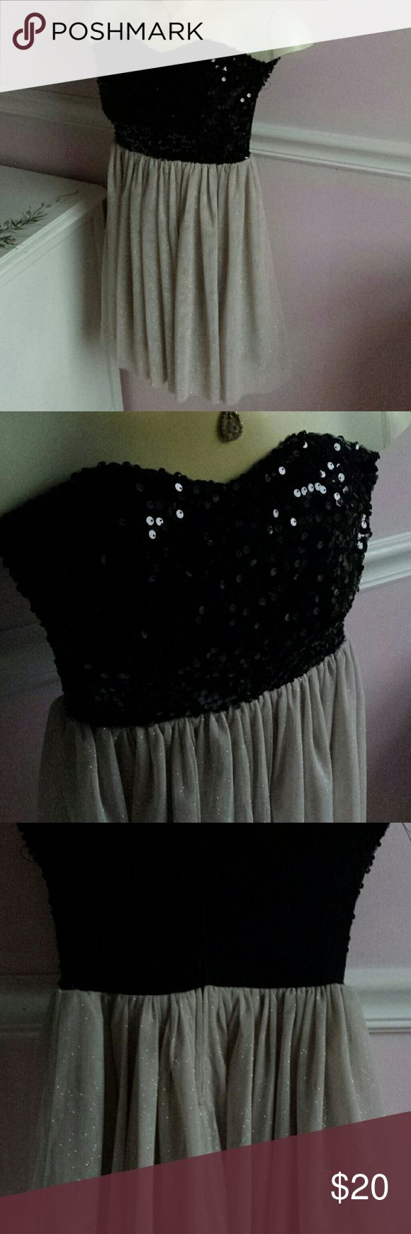 Black sequin and gold formal dress Black sequin formal dress by Delia's. Sequins are only on the front. Skirt is gold and with gold sparkles. Cute, short length. Dresses Mini
