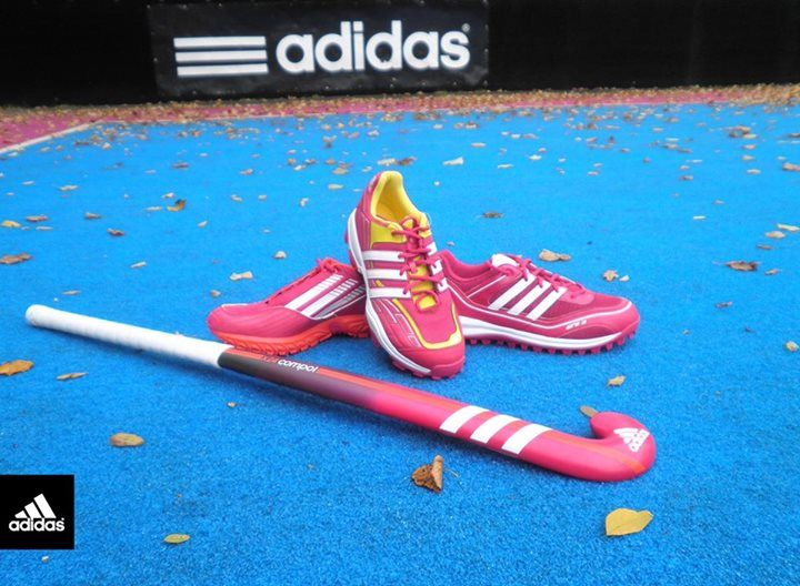 Field hockey stick and shoes , adidas