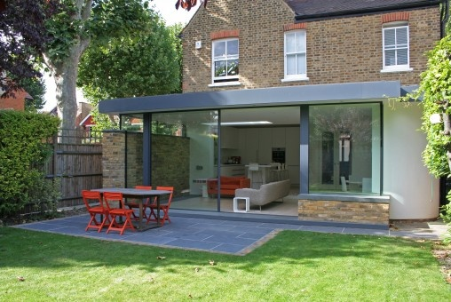 Contemporary extension, Ealing , London. Cantifix glazing and pressed aluminium detailing. duncan foster architects