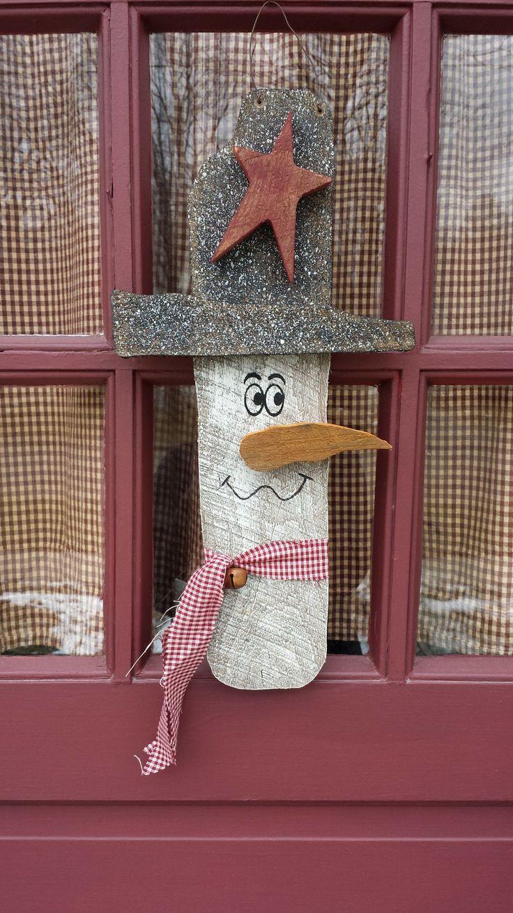 Rustic door hanging snowman we made :)