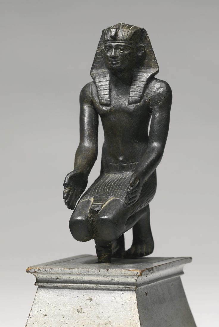 An Egyptian Bronze Figure of a King, 30th Dynasty/early Ptolemaic Period, circa 380-250 B.C.