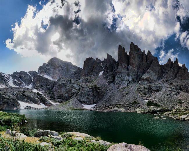 The Sharkstooth looms over Sky Pond in Rocky Mountain National Park.
