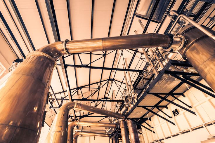 Stills connected by lyne arms into condensers at Glen Ord Distillery (The Singleton) Glen Ord Distillery | Highlands Roadtrip | Northcoast 500 | Wandering Spirits Global