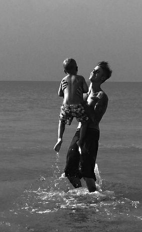 Him with our kid in the future and me looking from the sounds looking at the two boys i love most i mean i know it's a dream and all but he makes a great dad and too have kids with him is a dream come true
