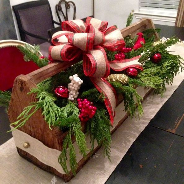 Vintage wooden toolbox decorated with thrifted items to create a beautiful Christmas centerpiece