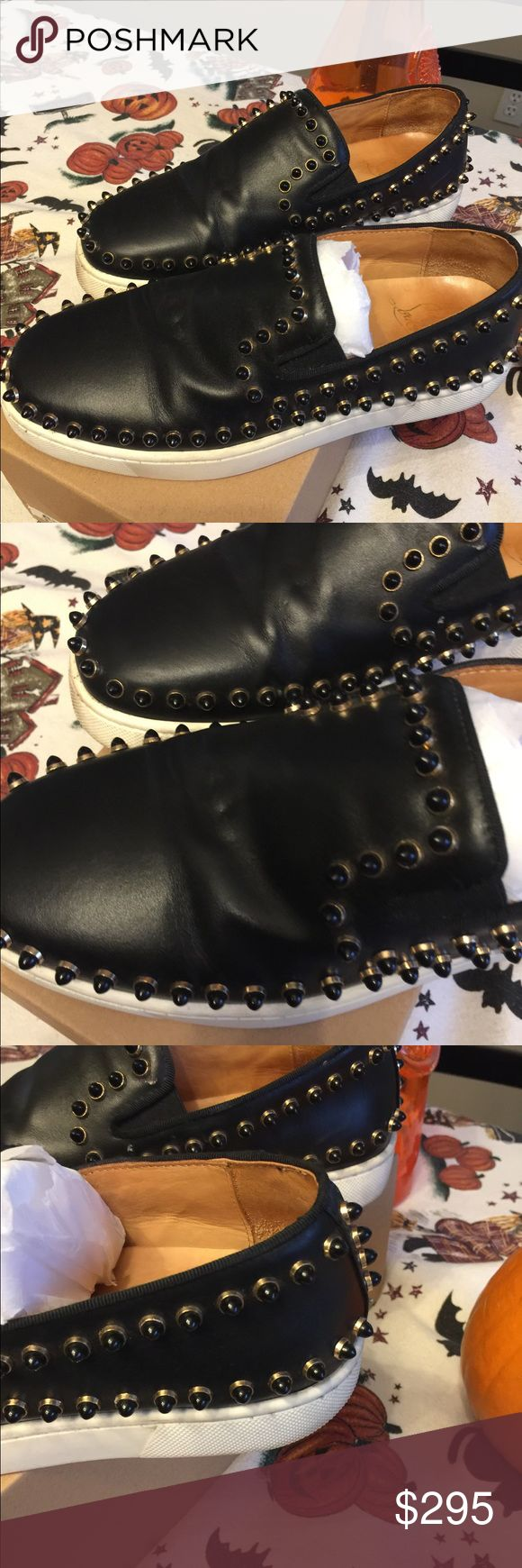 Christian Louboutin Pik Boat black slip on shoe Black leather with spikes in the comfort stylish slip on shoe authentic. Wear on back on heels and one spike is missing on left lower bottom of shoe. Christian Louboutin Shoes Sneakers