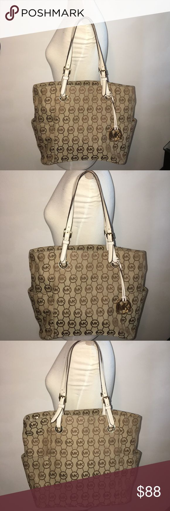"""Real Michael Kors Monogram tote bag. Real Michael Kors Monogram tote bag, with code AV-1111, Beige and Brown MK monogram fabric, Cream leather straps, beige MK monogram inside, gold hardware. 10.5"""" X 15"""" X 5.5"""" Looks in good condition, No tears, normal wear on the corners and on the straps, nothing terrible, Please read the description well, So I do not have to get any returns.  -No holds.  -No trades. -Firm Price, No more discounts for this bag, It is not easy to find good prices for…"""