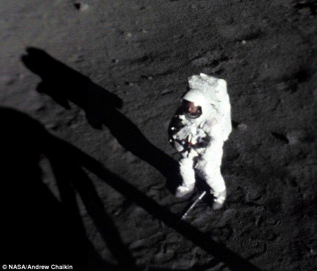 new still image that shows Neil Armstrong's face for the first time as he walks on the moon