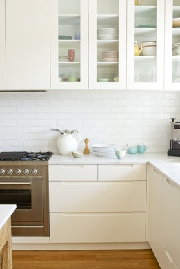 Subway tile splashback, kitchen base cupboards. #Duckegg blue highlight