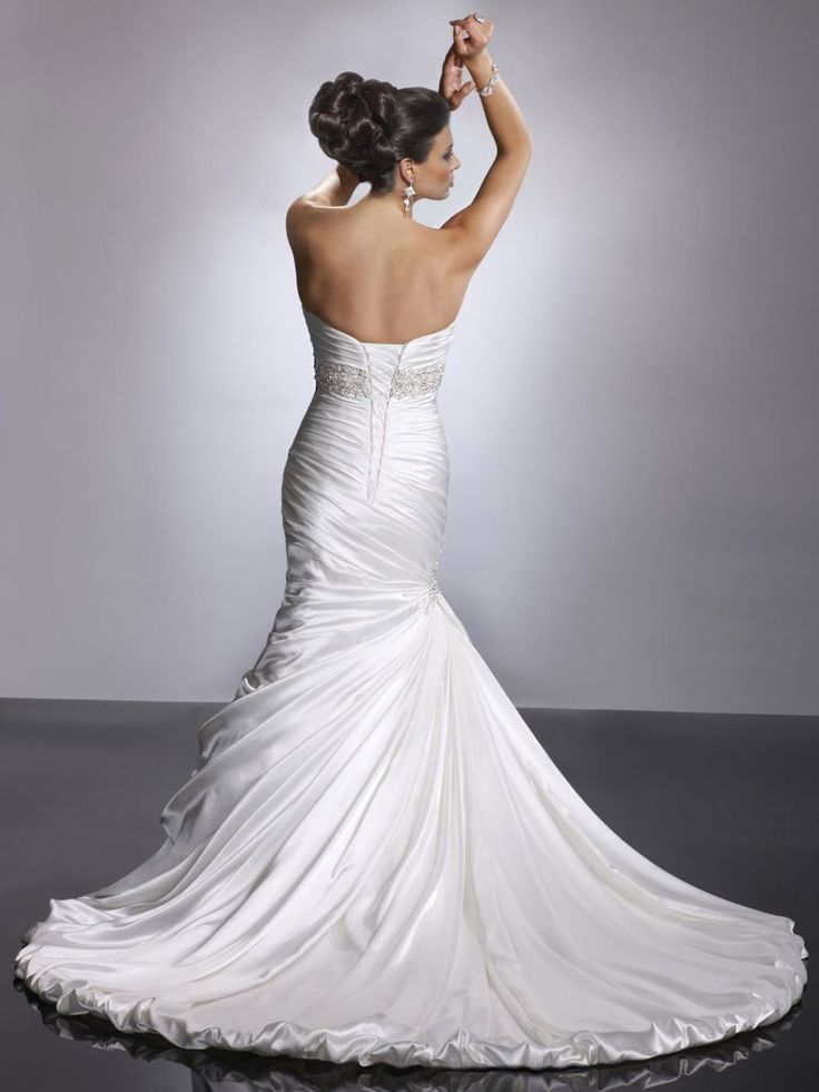 Sottero and Midgley - ADORAE, Fit and flare wedding gown with sweetheart neckline and available with corset closure or zipper back closure. Demir Stretch Satin provides sleek luster to this slender silhouette. Ruching envelopes the bodice and asymmetrically plummets below the waist, while the train pours into a gorgeous balloon hem.