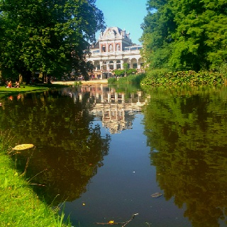 Reflection of a building in Vondel Park, Amsterdam.