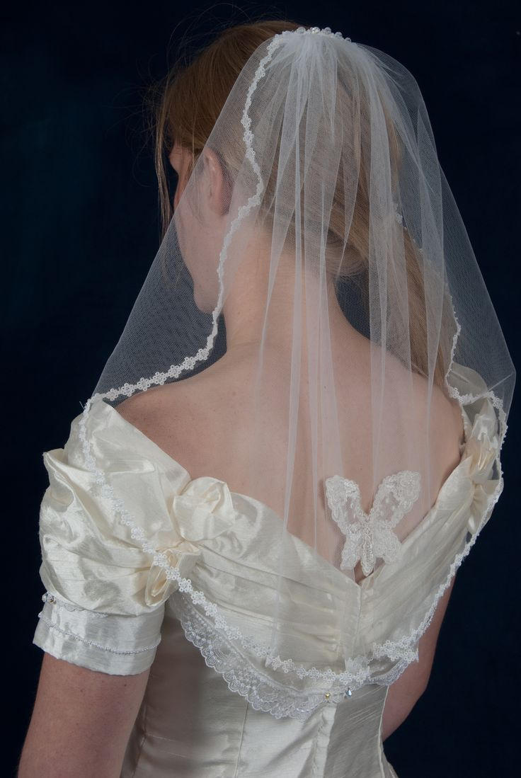 Handmade silk tulle shoulder length veil with butterfly detail and beaded edge handmade by Beautiful Unique