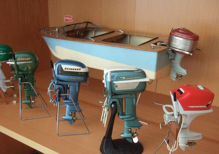 Assorted vintage toy outboard motors