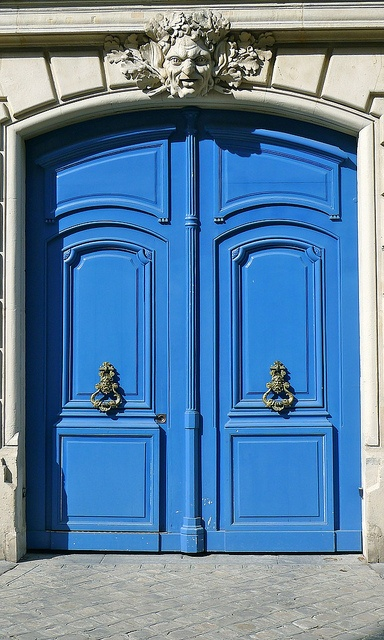 From the elaborate hardware to the Mediterranean blue color, we love everything about this front door