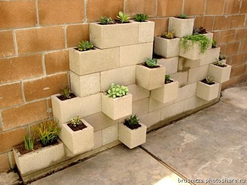 Cute use of cinder blocks. This Russian site has gorgeous pathways etc