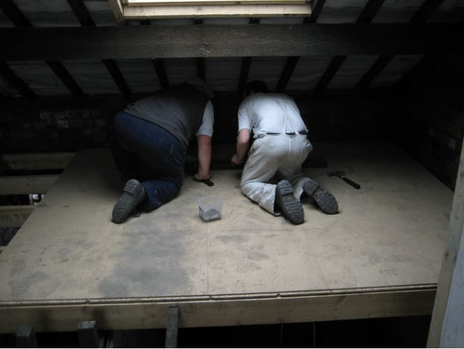 Sneaky Photo Of Two Canopy Housing Workers After Almost Completing The Renovations On An Empty Property