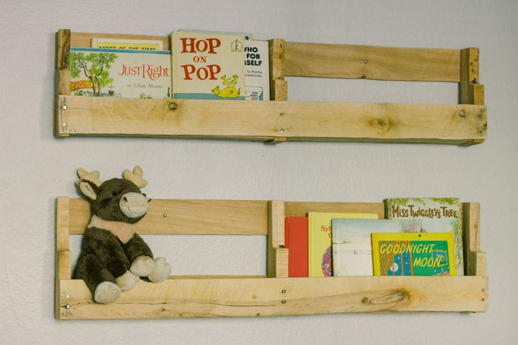 shelves on the wall... made out of pallets. EJ can do this