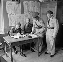 Otto Wagener (29 April 1888 – 9 August 1971) was a German major general and, for a period, Adolf Hitler's economic advisor and confidant. Wegener signs the instrument of surrender for the German forces in the Dodecanese to the British, 8 May 1945.