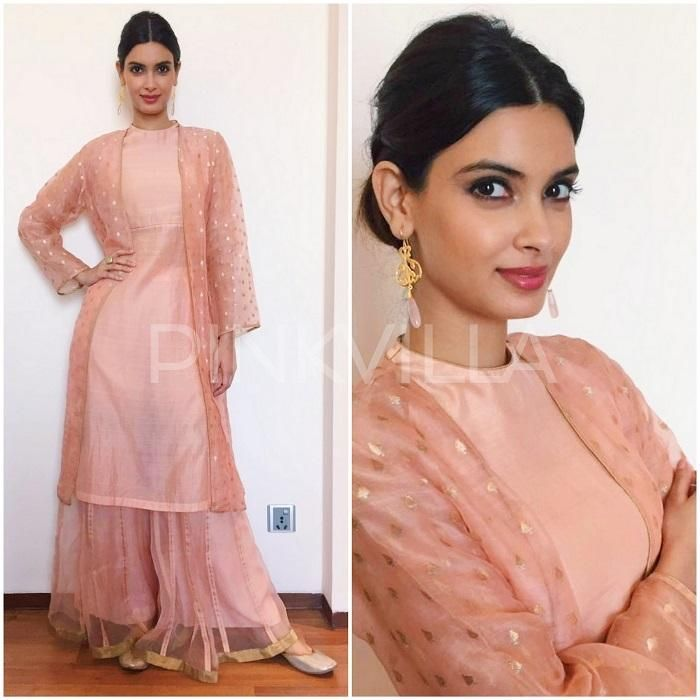 LOVE @DianaPenty's #HappyBhagJayegi promotional looks: in Indian traditional look in a salmon pink kurta, jacket and palazzo lehenga skirt, all by Raw Mango by Sanjay Garg. The layered look was styled with Amrapali earrings and Fizzy Goblet jootis with a simple bun rounding the look out... She's always so well put together and never boring or OTT! via www.TopUpYourTrip.com