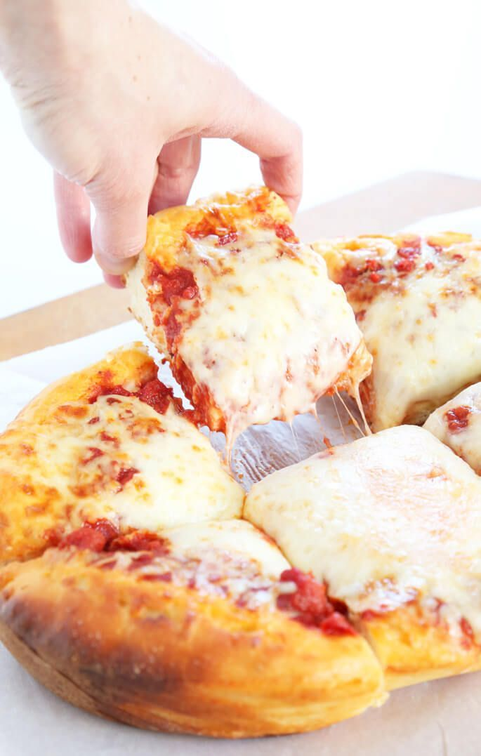 Slow Cooker Deep Dish Gluten Free Pizza   Now this is what I call a delicious pizza recipe! Just look at all of that cheese!