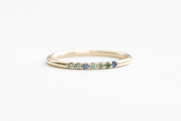 Green diamond and blue sapphire pave band