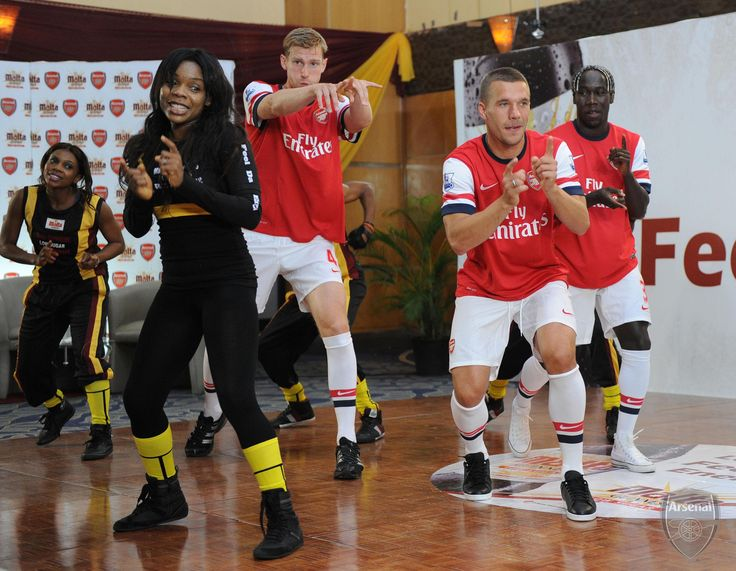 https://flic.kr/p/cSaodL | Lukas, Per and Bac filming an ad | LAGOS, NIGERIA - JULY 29:  Bacary Sagna, Per Mertesacker and Lukas Podolski of Arsenal FC take part the Malta Guinness Low Sugar Workout on July 29, 2012 in  Eko Hotel, Lagos, Nigeria.  (Photo by David Price/Arsenal FC via Getty Images) *** Local Caption *** Bacary Sagna; Per Mertesacker; Lukas Podolski
