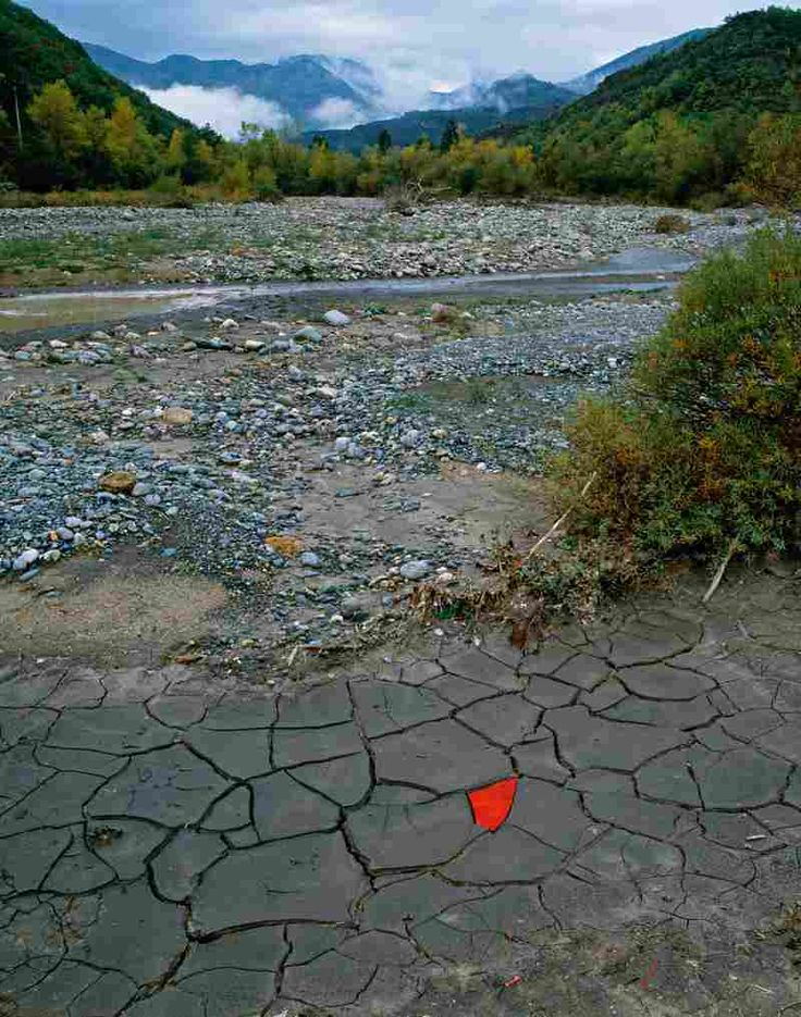 Red leaves cover a patch of cracked river clay in Digne-les-Bains, France. (Oct. 13, 2004) Andy Goldswerthy