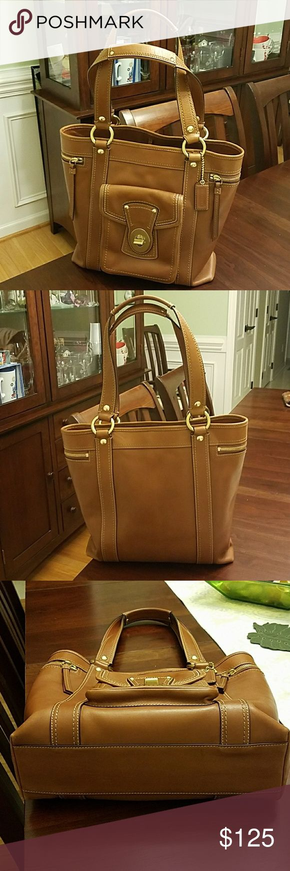 Coach Tote Bag Selling a used Coach Tote bag. Has some normal wear overall with minor stain inside. Hardly noticeable. And small pen mark. Has some normal wear on corners as pictured. Normal wear on handles. Very sturdy bag.  Color is british tan. Please no lowballing. Will consider reasonable offers. Coach Bags Totes