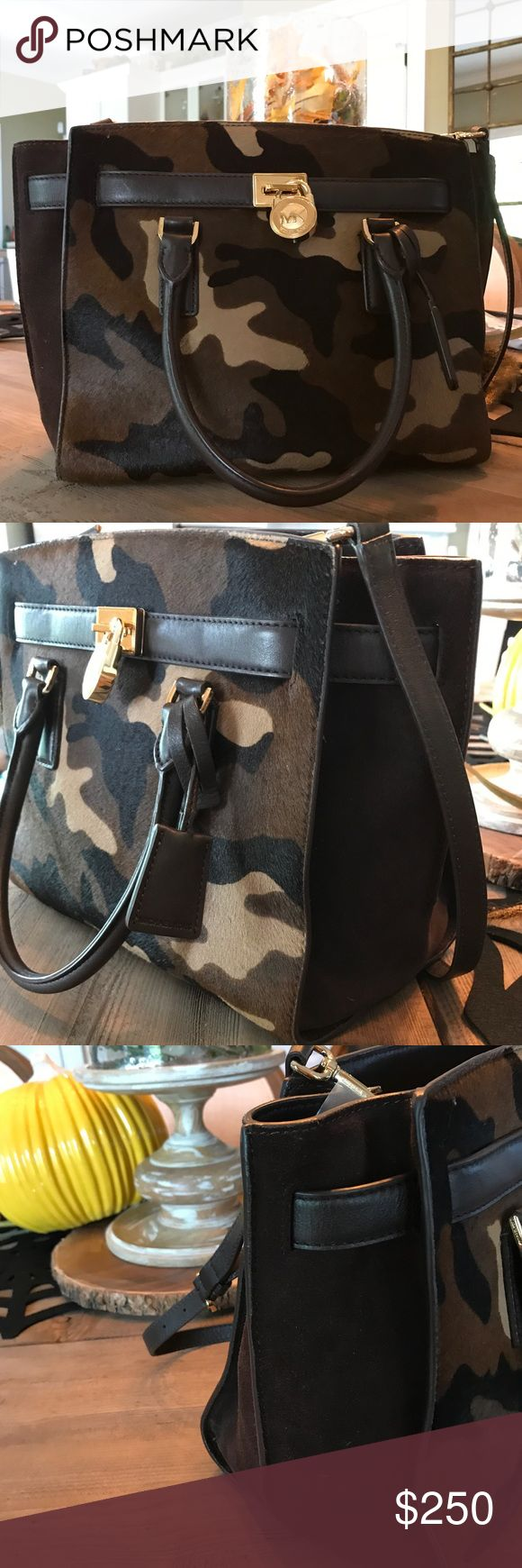 Michael Kors Camo Calf Hair Hamilton Bag / Purse Michael Kors Camo Calf Hair Hamilton Bag. Originally $395! Calf hair camo front with chocolate brown suede sides and chocolate leather for straps, back and bottom. Zip closure. Inside four pockets and one zip pocket. Key hook and detachable shoulder strap included. Slight discoloration on bottom. But otherwise Looks like new! Michael Kors Bags