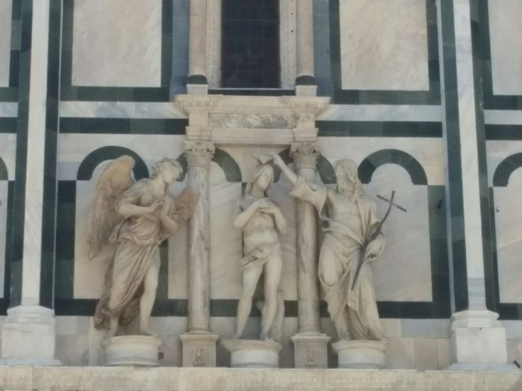 Statue of a baptism on the Duomo