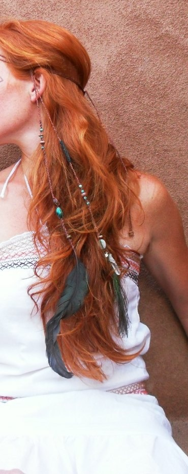 Long, bright red hair with braids, feathers and beads.