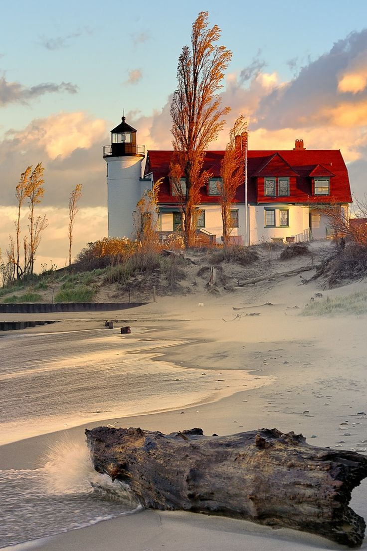 Beautiful house and lighthouse on a windblown beach - love the use of light in this photo