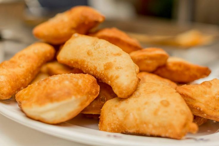 """The word """"panzerotti"""" comes from the Italian word for stomach—pancia—which reflects their belly-like shape. One of the simplest versions is filled with mozzarella and fresh tomato sauce. Do not miss them!"""