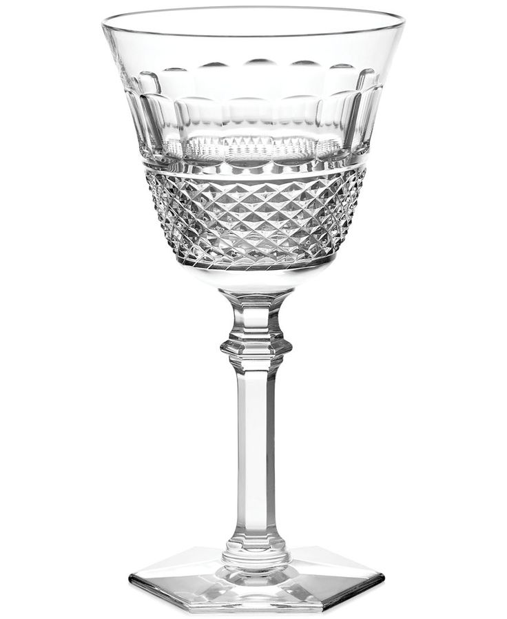 Diamond cut details complement the slender, graceful forms of this crystal Baccarat red wine glass. Designed by Thomas Bastide, the glittering look of this piece adds instant elegance to any dinner ta
