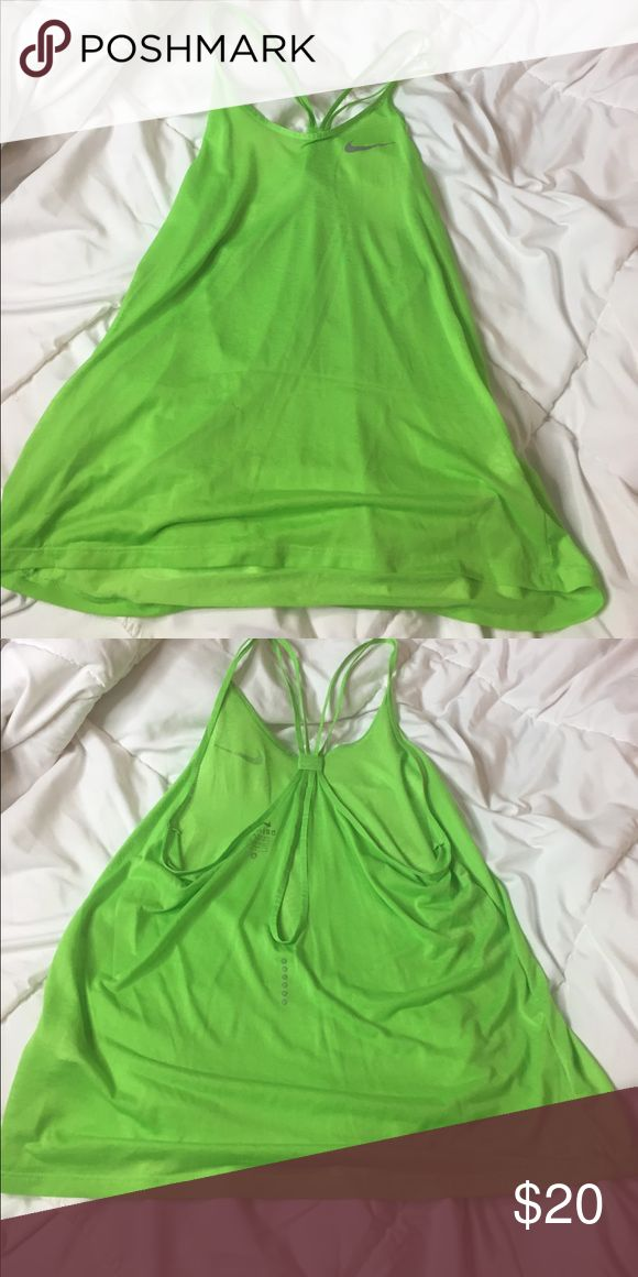 Lime green Nike workout top Lime green Nike double strapped shirt , lightweight, sheer worn once size small Nike Tops Tank Tops
