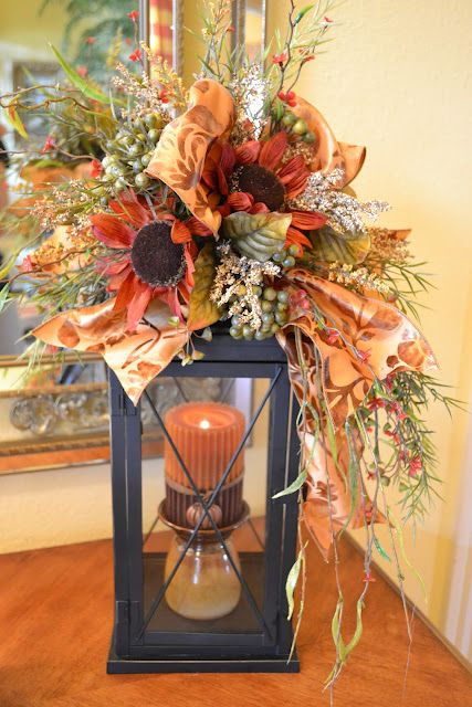 An easy idea to add to any lantern! Dress it up with ribbons and faux flowers from any craft store.
