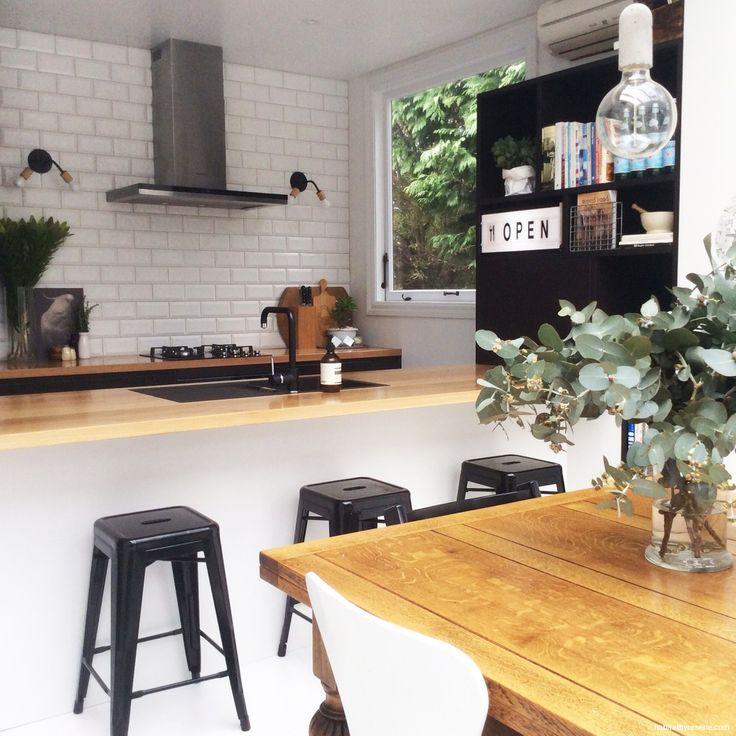 Talia's love affair with black and white has extended to her recently renovated kitchen, where the cabinets are painted in a mixture of Resene Bokara Grey an...