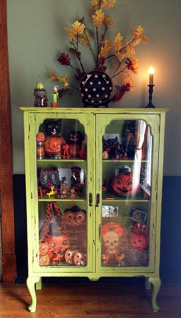 Nothing scary here! Just a charming display of vintage Halloween decor in an antique cabinet. Great for the entryway or dinning area.