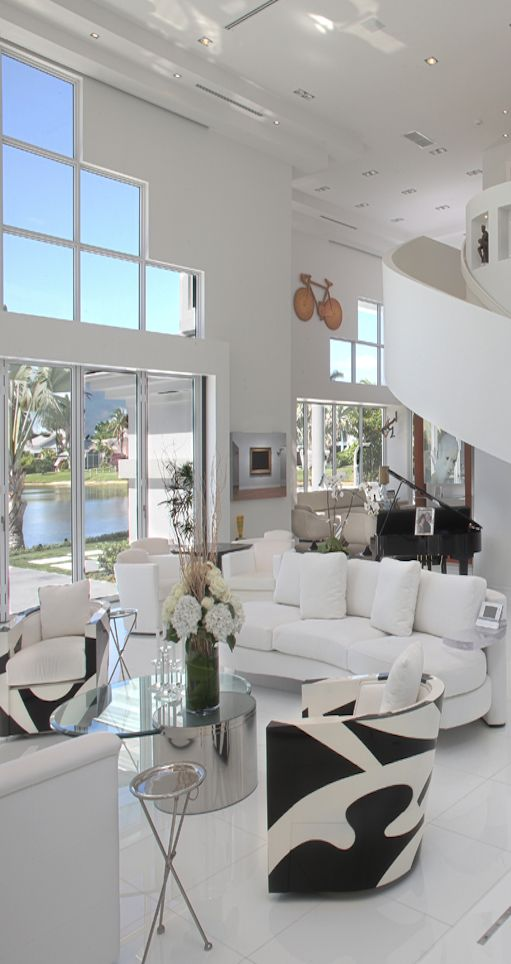 white with black accent and wall of windows makes for beautiful look and contrast