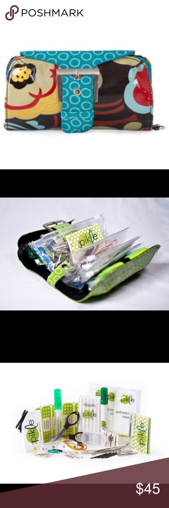 "Pikle bag with matching strap Be prepared for life's emergencies with a fully loaded Pikle bag. Includes: hand sanitizer pen, spot remover pen, antibacterial wipes, mini mirror/floss combo, tweezers, fingernail clippers, emery boards, travel size sewing kit, retractable mini scissors, 24"" tape measure, hair bands, rubber bands, bobby pins, safety pins, paper clips, mini screw driver, mini pen, sticky notepad, adhesive bandages, travel tissues and a pill box. Gift box included!!! Accessories"