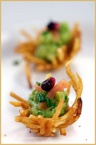 Finger food is alway fun Deep-dried potaot nests with avocado and smoked salmon garnish here.   hmmm... yummy recipe
