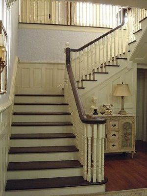 Wainscotting in the stair well and I love the colors on the stairs!