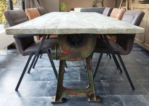 This Industrial Design Table Has Old Cast Iron Legs As A Base And A Sturdy Industrial  Tabletop Of Reclaimed Oak Carriage Planks.
