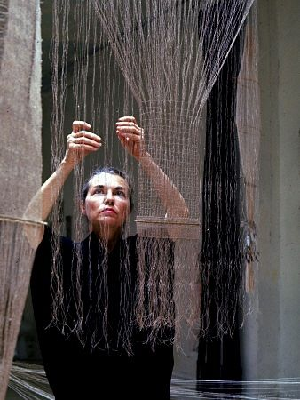 Artist and weaver, Lenore Tawney, at work.