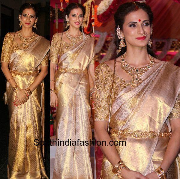 Shilpa Reddy in a gold kanjeevaram saree