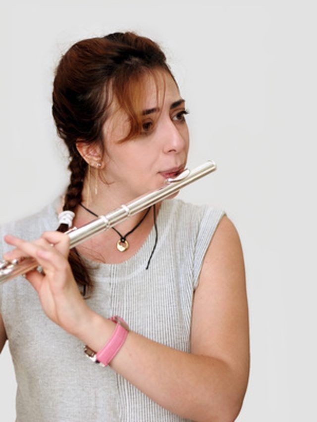 Muscian holding a flute like your child will hold the paper towel flute.