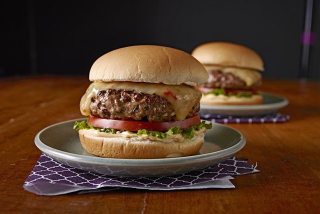 Ground beef, chipotle peppers, cilantro and garlic make the ultimate burger patties. Just add cheese and toppings to finish the gourmet experience.