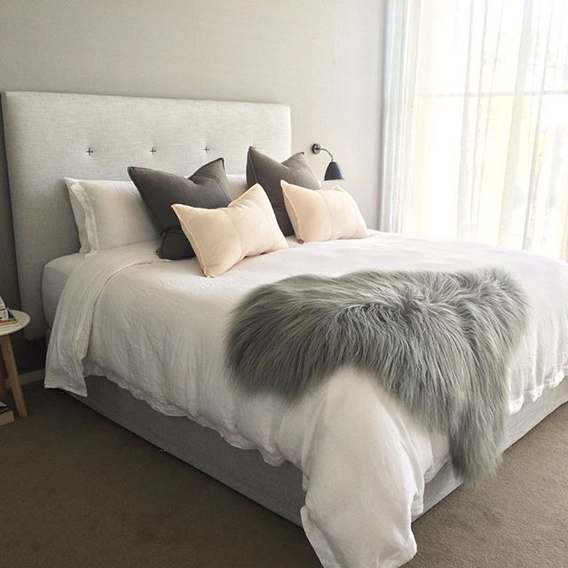 Linen sheers ✔️Gubi bedside lights ✔️Heatherley bed ✔️Silk wallpaper ✔️Eadie feather cushions ✔️Natures Collection sheepskin ✔️Beautiful norsu styling clients ✔️✔️✔️ (http://www.norsu.com.au/brands/Eadie-Lifestyle.html?sort=alphaasc)