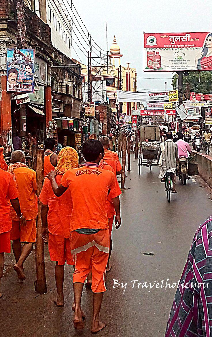 Devotees throng in Varanasi during the auspicious month of shravan. Read: https://travelholicyou.wordpress.com/2016/05/01/top-5-destinations-where-you-must-take-your-parents-on-vacation/ #Varanasi #Kanwariyas #Travel #Travelholicyou
