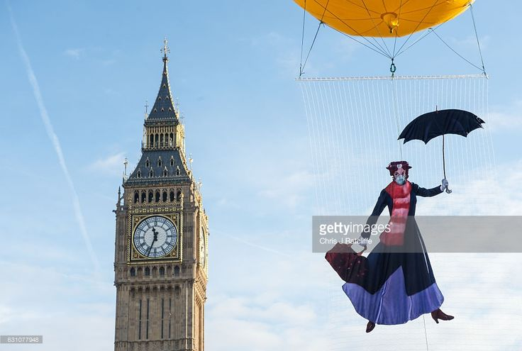 Greenpeace activists float a picture of Mary Poppins wearing a gas mask in front of the Houses of Parliament to highlight that London has breached its annual air pollution limit for 2017 in just five days at Parliament Square on January 6, 2017 in London, England. By law, hourly levels of toxic nitrogen dioxide must not be more than 200 micrograms per cubic metre more than 18 times in a whole year, but late on January 5th this limit was broken on Brixton Road in Lambeth.  (Photo by Chris J…